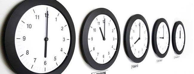 Wall clocks in line displaying international time