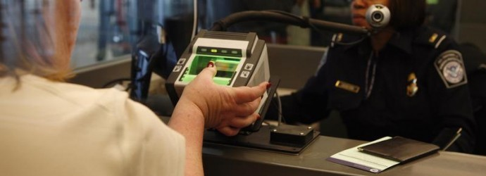 Traveler has her fingerprints scanned at international travel entry point at JFK International Airport in New York